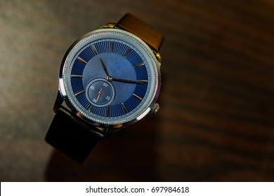 Luxury timepiece on wooden background