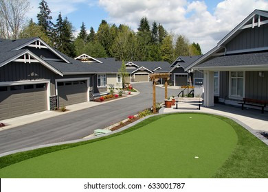 Luxury town homes with a practice golf green.