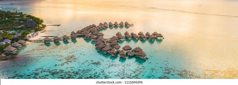 Luxury travel vacation destination panoramic banner. Romantic honeymoon getaway in overwater bungalows villas of Tahiti resort, Bora Bora, French Polynesia. Landscape copy space panorama. - Shutterstock ID 1115696396