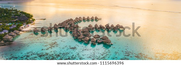 Luxury travel vacation destination panoramic banner. Romantic honeymoon getaway in overwater bungalows villas of Tahiti resort, Bora Bora, French Polynesia. Landscape copy space panorama.