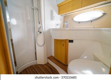 Luxury traveling. Bathroom interior of modern motor yacht.