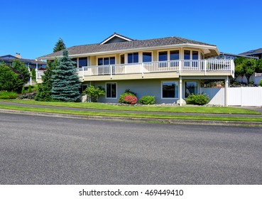 Luxury two level house exterior with large balcony. Nice landscape desing around. View from driveway. Northwest, USA