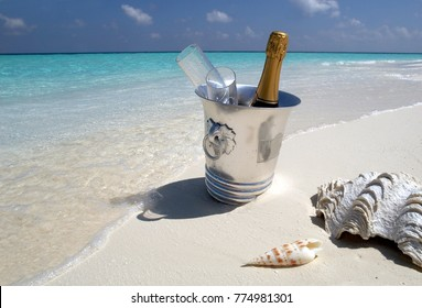 Luxury Vacation - Champagne on ice for two, on a tropical beach in the Maldives.
