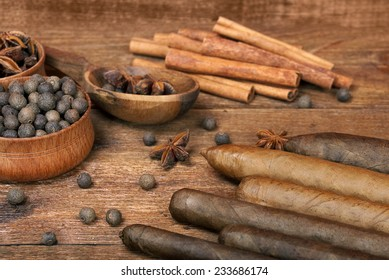 Luxury variety of Cuban cigars are on the wooden table