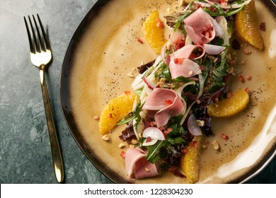 Luxury vegetable salad with Smoked duck breast.  Healthy fresh vegetable salad with smoked chiken meat, Candied Walnuts, Spring Greens, Orange and Herbs