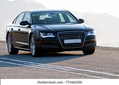 Luxury vehicle on tar road