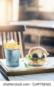A luxury version of the classic burger and fries in an upmarket restaurant.