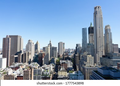 Luxury views of New York City skyscrapers on a clear blue day