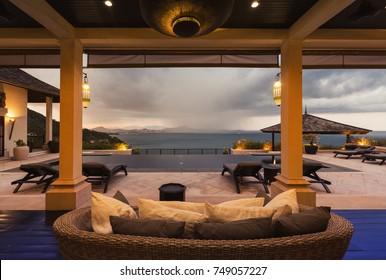 Luxury villa living room interior. Sea and bid private swimming pool view veranda