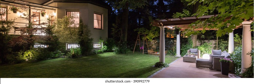 Luxury villa with patio in garden at night