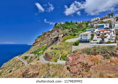 Luxury villas built into the hillside in the upmarket area of Garajau, Madeira Island, Portugal.