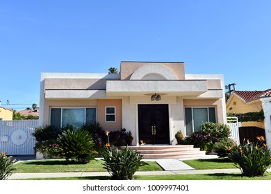 Luxury villas and estates with nicely landscaped front yard in an upscale neighborhood of Los Angeles, CA.