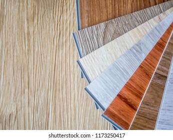 Luxury vinyl click lock type of sample color on wood floor space