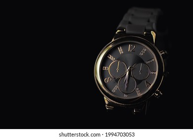 Luxury watch on a black background, copy space available.