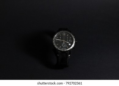 Luxury watch on black background black silver watch