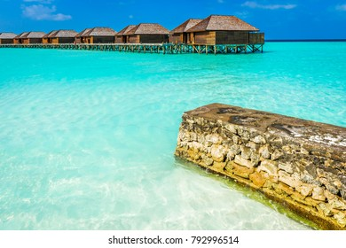 Luxury water villas on tropical Maldives island, Indian Ocean