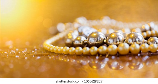 Luxury, wealth concept - beautiful silver and golden pearls jewelry - web banner with blank, copy space