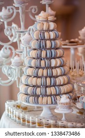 Luxury wedding candy bar table set. Macaron tower or pyramid and cupcakes on sweet dessert table. Pastel stylish colours., sweets, treats