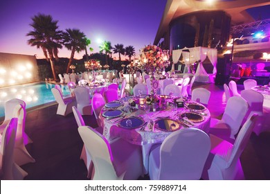 Luxury wedding decorated round tables