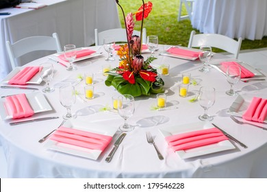 Luxury wedding lunch table setting outdoors, in white and pink colors.