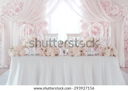 luxury wedding table with beautiful flowers.  pink stylized