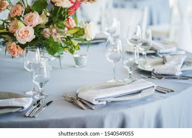 Luxury wedding table decoration. Special event table set up. Fresh flower decoration. Pastel colors - blue and pink decoration