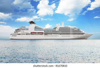 Luxury white cruise ship on a clear day with calm seas