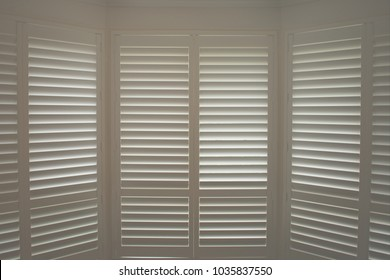 Luxury white indoor plantation shutters, closed shutters
