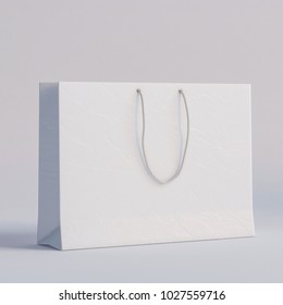 Luxury white paper bag on a white background.