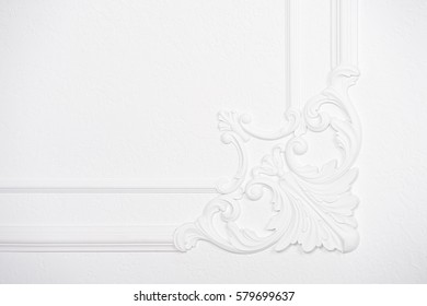 Luxury white wall design bas-relief with stucco mouldings roccoco element. Decorative elements wall, stucco