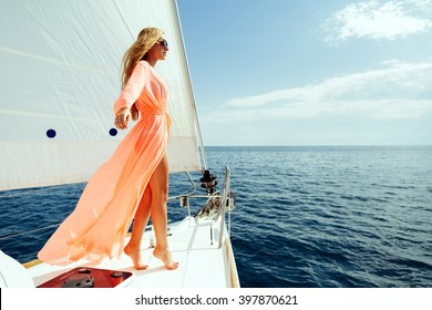 luxury woman pareo yachting boat trip in sea with blue sky sunlight