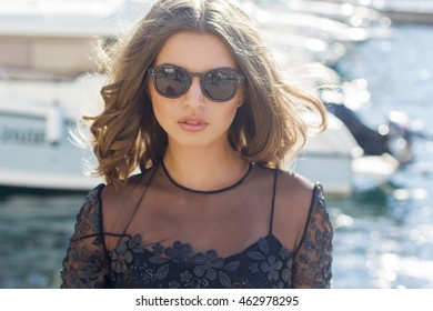 Luxury woman is wearing black sunglasses