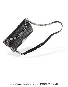 Luxury women's handbag isolated on white background. Steel chain and black genuine leather with texture. Free space and shadow