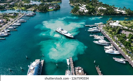 Luxury Yacht Boat Stirring up sand in marina in the Bahamas