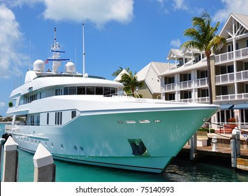 Luxury Yacht Docked In Front Of Waterfront Condominiums