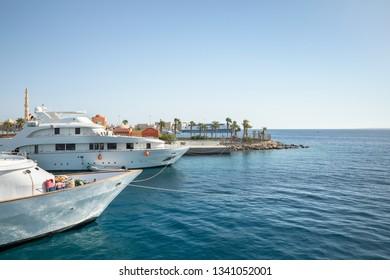 Luxury yacht docking near dock