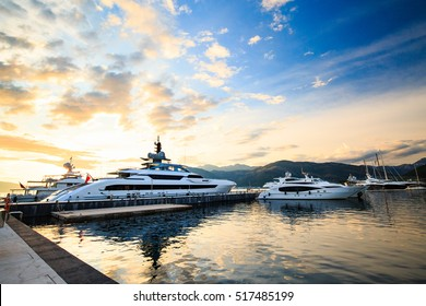Luxury yacht marina. Port in Mediterranean sea at sunset.