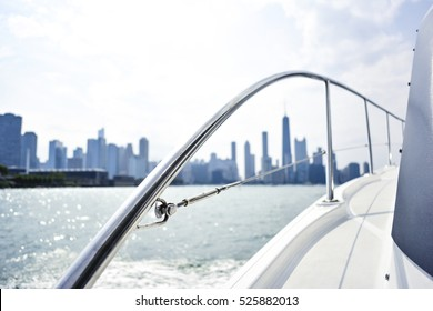 Luxury yacht overlooking abstract city skyline in the summertime