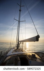 Luxury Yacht Sailing In Sea During Sunset