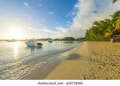 Luxury yachts along Grand Baie tourist beach in Mauritius