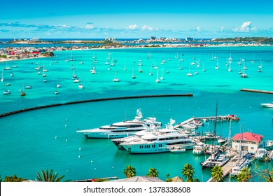 Luxury yachts and boats in the marina of Marigot, St Martin, Caribbean.