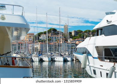 Luxury yachts in the Le Vieux port of Cannes in front of the old town