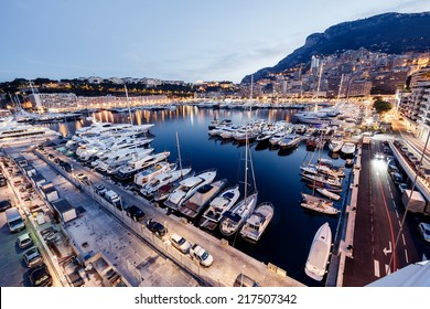 Luxury yachts in Monaco harbor at evening
