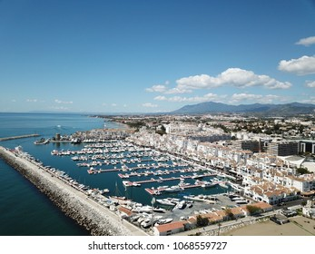 Luxury yachts moored in the harbor of this beautiful, Spanish coastal town.An aerial view of Puerto Banus Harbour, Spain