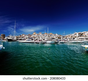 Luxury yachts and motor boats moored in Puerto Banus marina in Marbella, Spain. Marbella is a popular holiday destination located on the Costa del Sol in the southern Andalusia