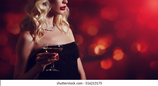 Luxury young woman with glass of champagne.