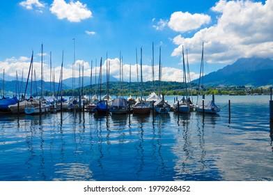Luzern, Schweiz - June 2018: Boats parked in the harbor of Luzern Lake, Switzerland.