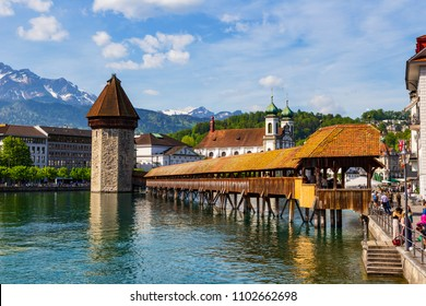 LUZERN, SWITZERLAND - APRIL 25:Chapel bridge famous place on lake Luzern with snow mountain behide, APRIL 25,2018, Lucerne, Switzerland. Chapel bridge famous place on lake Lucerne Switzerland, Europe.