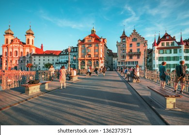 LUZERN, SWITZERLAND - AUGUST 11, 2018: Beautiful historic city center view of Lucerne with famous Chapel Bridge and lake Lucerne (Vierwaldstattersee), Canton of Lucerne, Switzerland