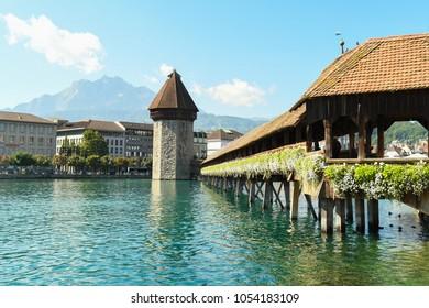 Luzern, Switzerland - August 18, 2017: Flowers adorn the Chapel Bridge on a summer day in Luzern